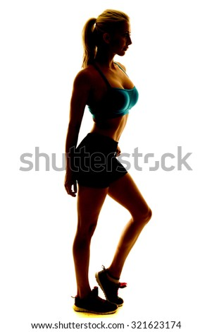 a silhouette of a woman in her fitness clothing. - stock photo