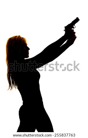 A silhouette of a woman pointing her gun into the sky.