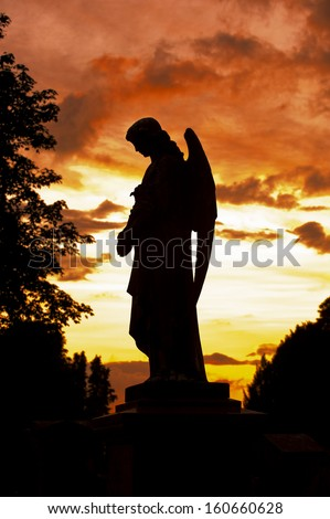 a silhouette of an angle statue