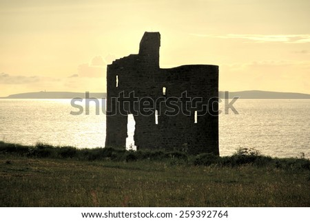 A silhouette of Ballybunion Castle in county Kerry Ireland - stock photo