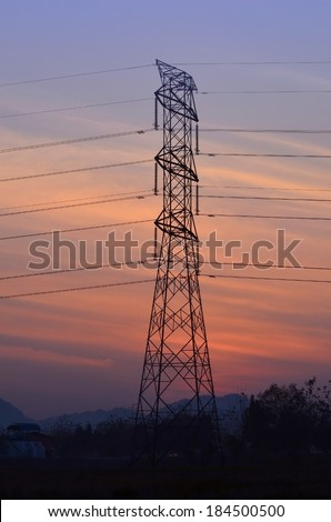 A silhouette of high voltage electricity pylons