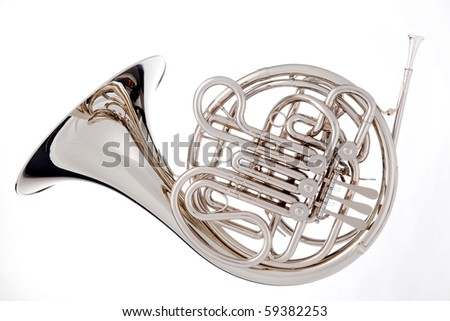 A silver French horn isolated against a white background in the horizontal format. - stock photo
