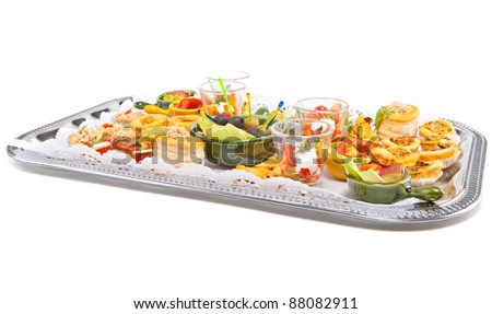 A silver plate full of fingerfood isolated over white background.