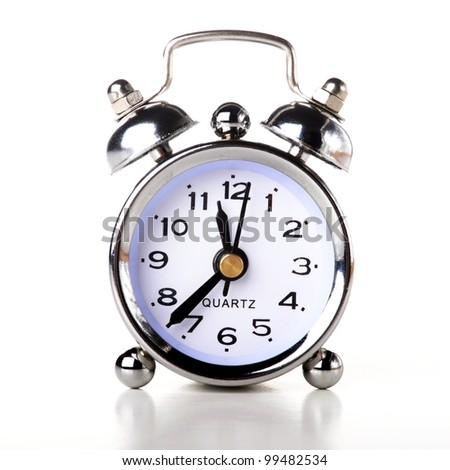a silver retro alarm bell on white background - stock photo