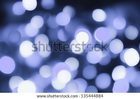 A simple, bright, pale blue bokeh design with frosty winter overtones.