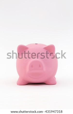 A simple, pink ceramic piggy bank sitting on a white vertical background. Plenty of copy space room. Great for a variety of ideas and concepts concerning finances, money, and savings.