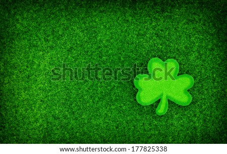 A simple Saint Patrick's Day background constructed out of Glitter featuring a single Shamrock shape.  - stock photo