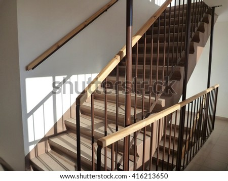 a simple staircase in a high modern building - stock photo