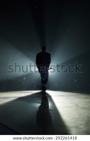A singer man silhouette on stage - stock photo