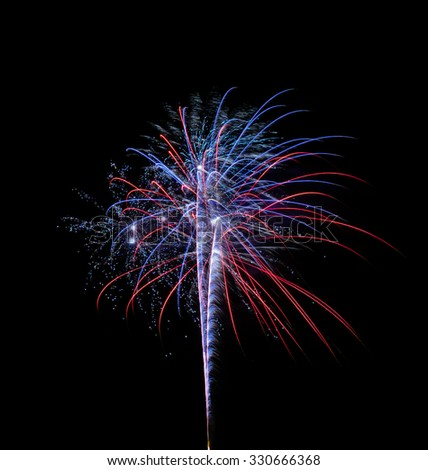 A single and colorful fireworks over a night sky isolated on black background