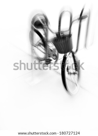 A single bike with basket in a bike rack in a city with zoom motion - stock photo