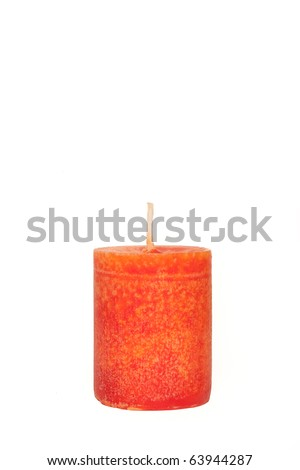 A single burning red candle isolated in front of white background