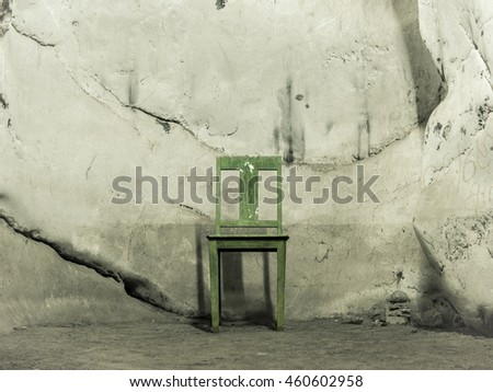 A single chair in the middle of cave wall in Prachuab Kirikhan, Thailand