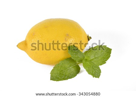 A single lemon fruit with a piece of mint isolated on white