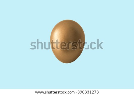 A single metallic golden egg on an isolated teal background for Easter. Horizontal format with plenty of room for copy space.