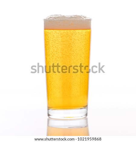 A single pint glass of a golden pilsner on a white background.