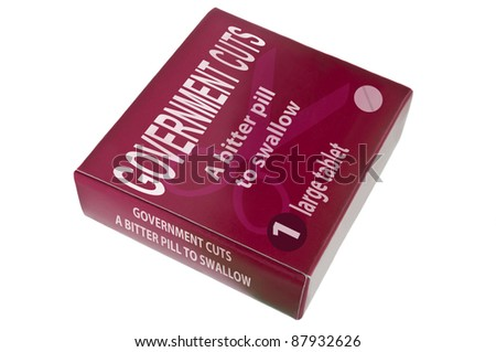 A single red medication pack with the words 'Government cuts a bitter pill to swallow' arranged over white. - stock photo