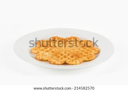 A single waffle on white plate - stock photo