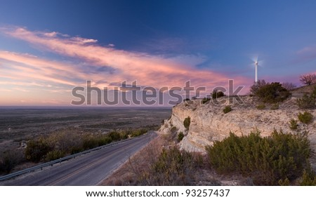 A single wind turbine on a ridge in west Texas during sunset