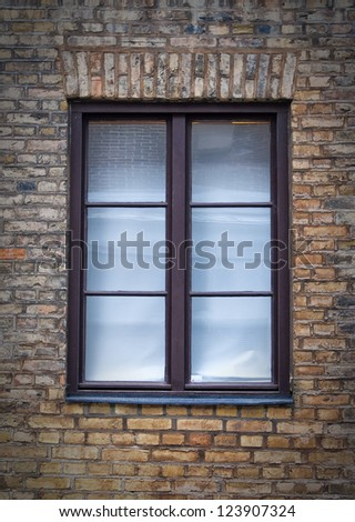 A single window with surrounding brickwork much like you would find in any town or city.