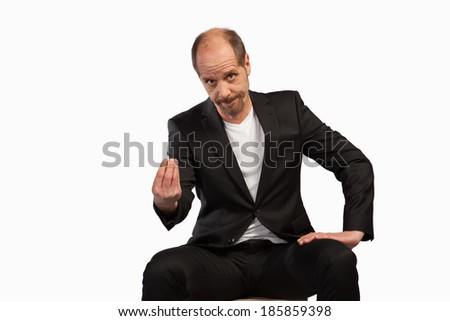 A sitting Businessman is using his fingers to form a gesture on a white background. - stock photo