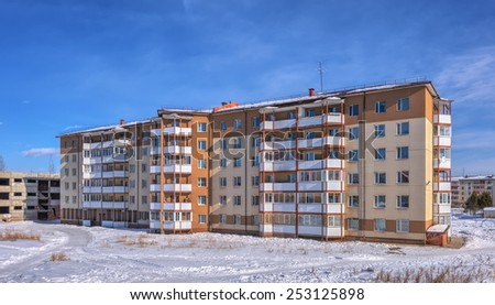A six-story apartment building in the Siberian city of winter - stock photo