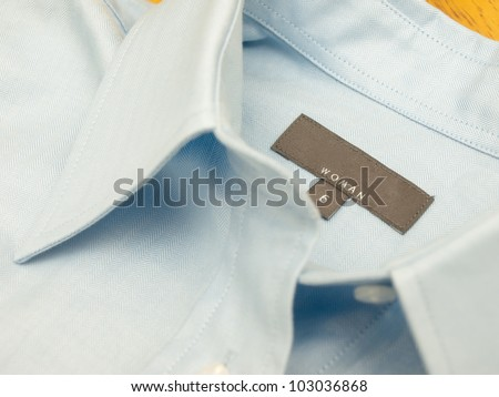 A size and brand tag on a finest-quality shirt - close up - stock photo