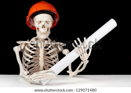 A skeletal architect with hard hat and building plan symbolizes planning that happened too late. - stock photo