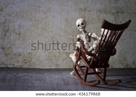 A skeleton,a little skeleton and the rocking chair - stock photo
