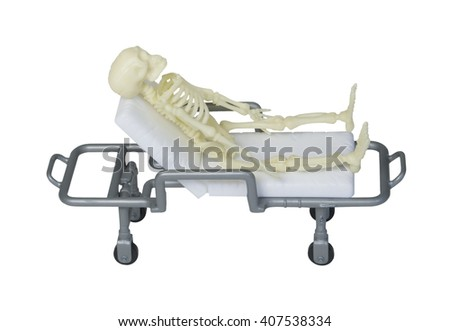 A skeleton laying out on a gurney - path included - stock photo