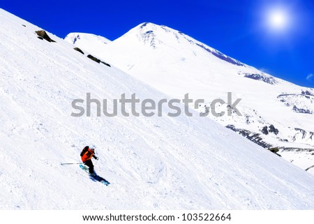 A skier descending Mount Elbrus - the highest peak in Europe. - stock photo