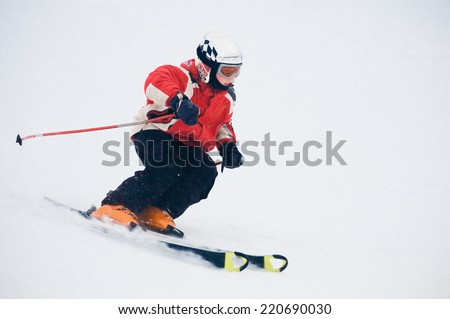 A skier descends from the mountain - stock photo