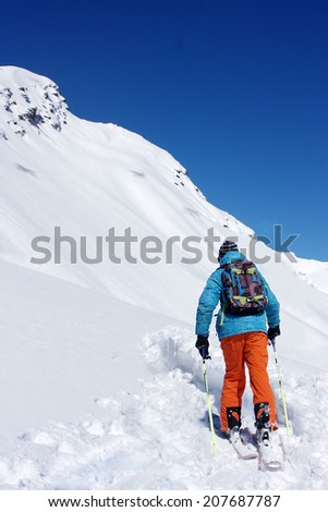 A skier going up in the mountains.