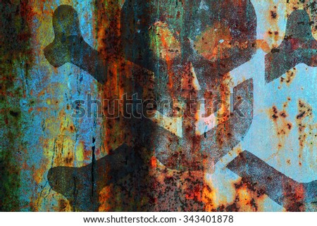 A skull and crossbones on rusty metal sheet - stock photo