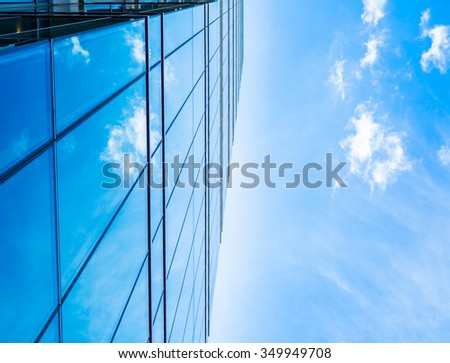 A sky reflect in the building show the cloud that move across the sky. Impress the sense of future