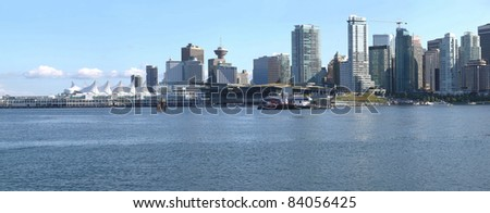 A skyline panorama view of Vancouver BC waterfront from Stanley park. - stock photo