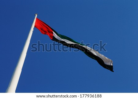 A skyward view of the UAE National Flag as it blows beautifully in the wind - stock photo