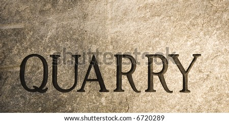 A slab of granite with the word quarry carved into it