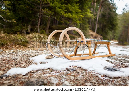A sledge located on a last patch of snow - stock photo