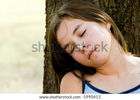 a sleeping girl in nature