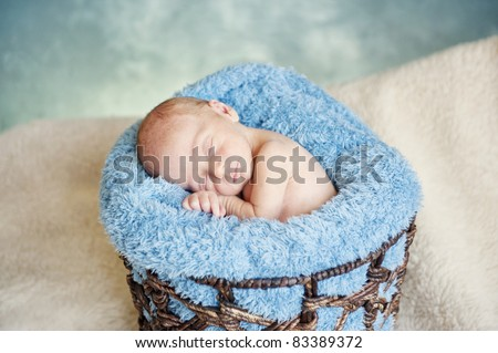 A sleeping newborn baby boy with focus on his face