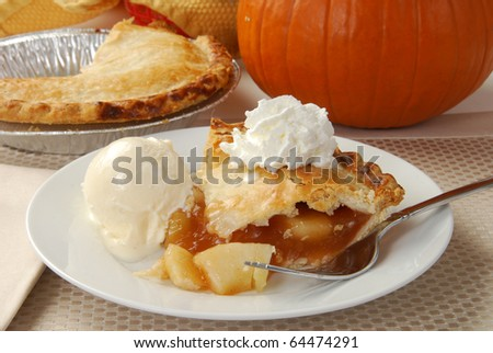 A slice of apple pie with vanilla ice cream and whipped cream - stock photo