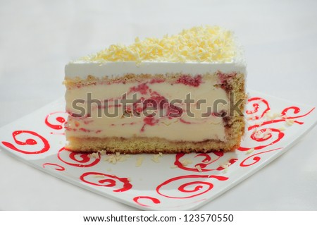 A slice of cheesecake on white background - stock photo