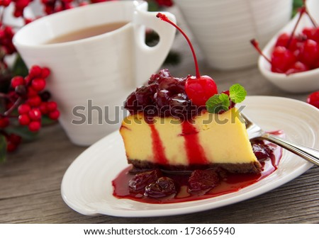 A slice of cheesecake with cherry sauce. - stock photo