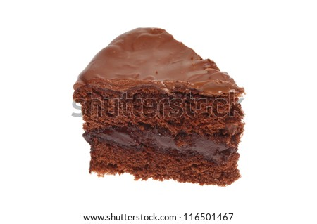 A slice of chocolate sponge cake isolated against white