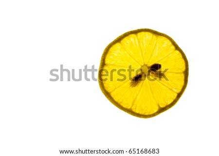 A slice of Lemon illuminated from behind - stock photo