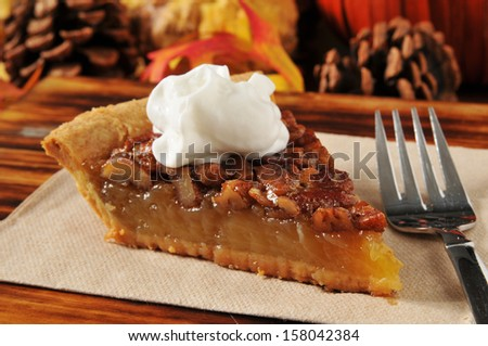 A slice of pecan pie on a holiday setting - stock photo