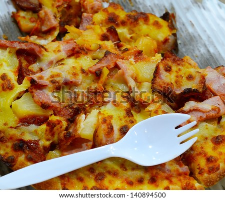 A slice of pizza with a fork - stock photo