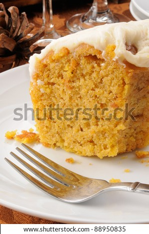 A slice of pumpkin cake with caramel butter cream frosting