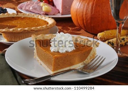 a slice of pumpkin pie with whipped cream for the holidays - stock photo